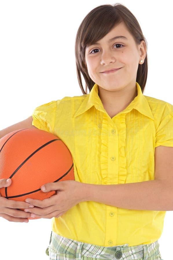 Esfera do whit da menina do basquetebol foto de stock
