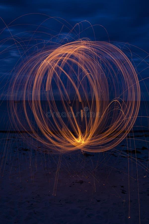 Esfera na praia foto de stock