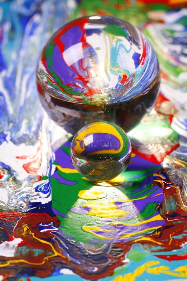 Esferas de vidro na pintura fotografia de stock royalty free