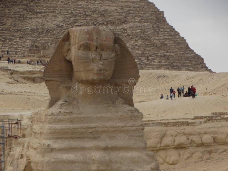 Esfinge y pirámides, Egipto de Giza imagenes de archivo