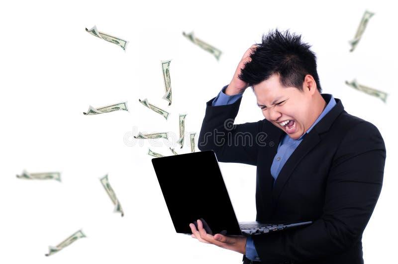 Esforço no local de trabalho com o dinheiro que voa para fora imagens de stock royalty free