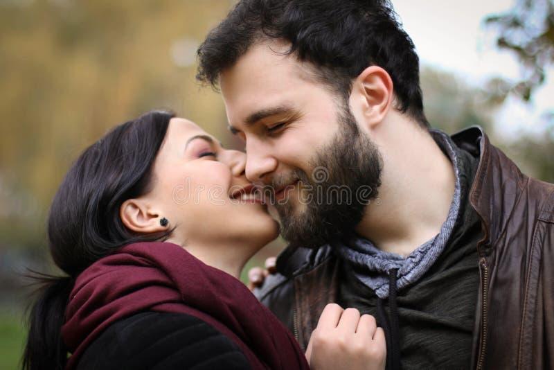 Eskimo kissing couple royalty free stock image