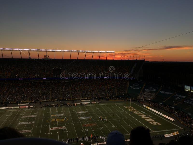 Eskimos Football Game. Sun setting below football stadium royalty free stock image