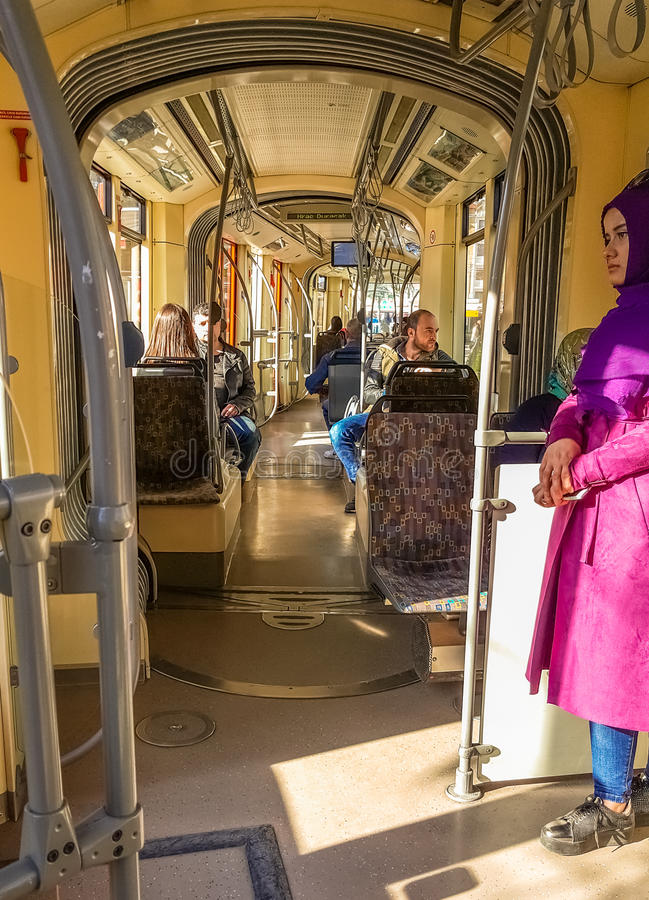 Eskisehir, Turkey - April 01, 2017: Passengers on Eskisehir tramway. Everyday life and commuting to work by tram stock image