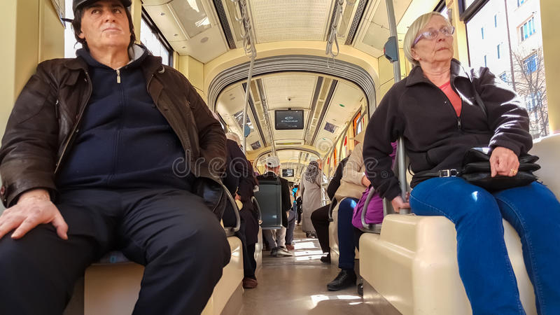 Eskisehir, Turkey - April 03, 2017: Passengers on Eskisehir tramway. Everyday life and commuting to work by tram stock image
