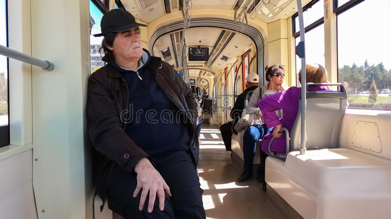 Eskisehir, Turkey - April 03, 2017: Passengers on Eskisehir tramway. Everyday life and commuting to work by tram stock photography