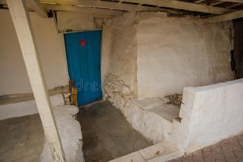 Eskisehir, Turkey: Blue wooden door in traditional Turkish house royalty free stock image