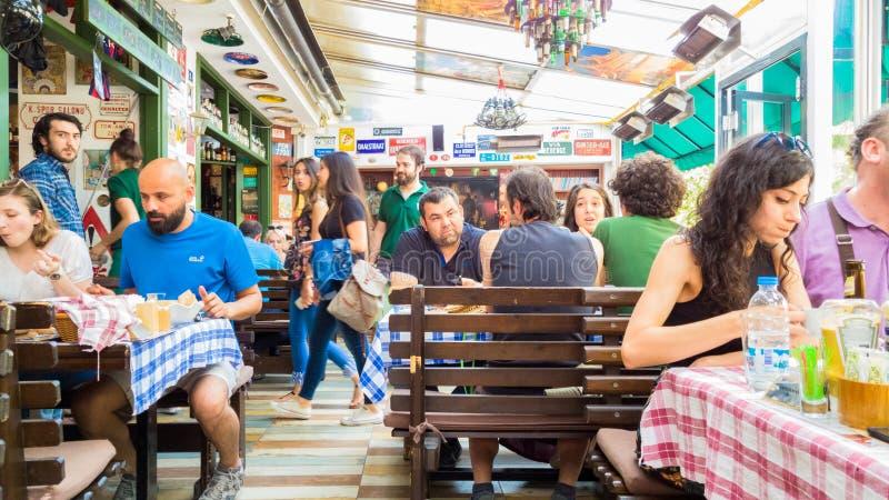 Eskisehir, Turkey - July 16, 2017: Customers and busy staff in modern world cuisine restaurant called Travelers' Cafe in Eskisehir stock image