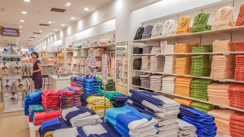 Eskisehir, Turkey - May 04, 2017: Beautiful brunette woman examining towels in a store in Eskisehir. Eskisehir, Turkey - May 04, 2017: Beautiful brunette woman royalty free stock photo