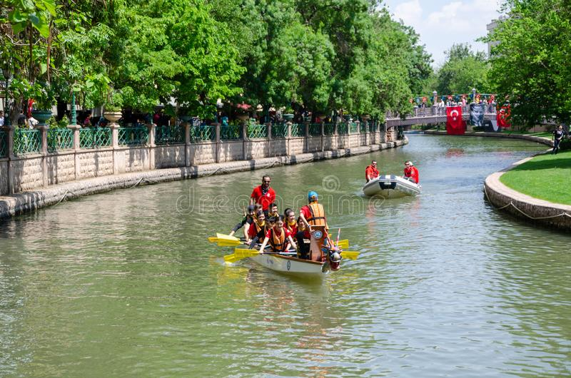 Traditional Canoe Race on the Porsuk River in Eskisehir/Turkey. Eskisehir, Turkey - May 19, 2019: Boat and canoe on Porsuk River in Eskisehir/Turkey stock images