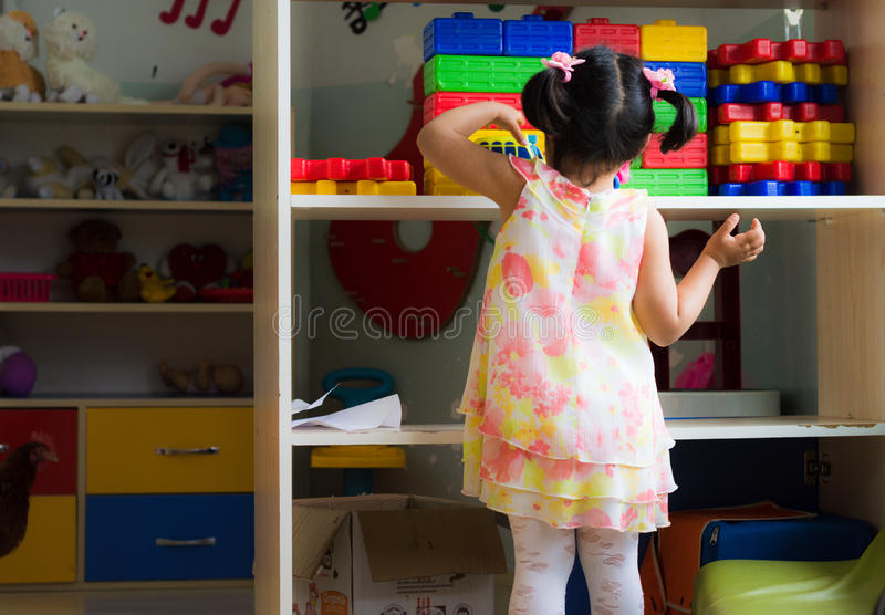 Eskisehir, Turkey - May 05, 2017: Little girl in dress playing with toys in kindergarten royalty free stock images