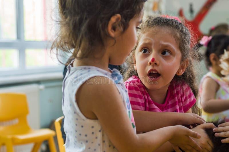 Eskisehir, Turkey - May 05, 2017: Preschool kids attending to an animal day event in kindergarten stock photography