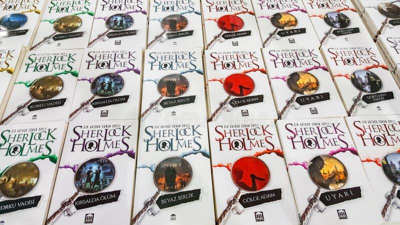Several Sherlock Holmes books displayed on the stand in Eskisehir Book Fair. Eskisehir, Turkey - October 09, 2018: Several Sherlock Holmes books exhibited on the stock photo
