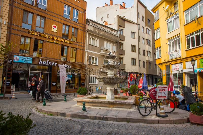 Eskisehir, Turkey: Street with traditional Turkish houses and fountain. Eskisehir is a modern city in center of Anatolia royalty free stock images
