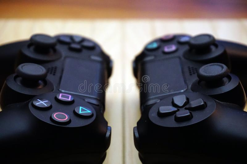 22.03.2019 Eskisehir, Turkey. Two ps4 gamepads on wooden background close up view royalty free stock image