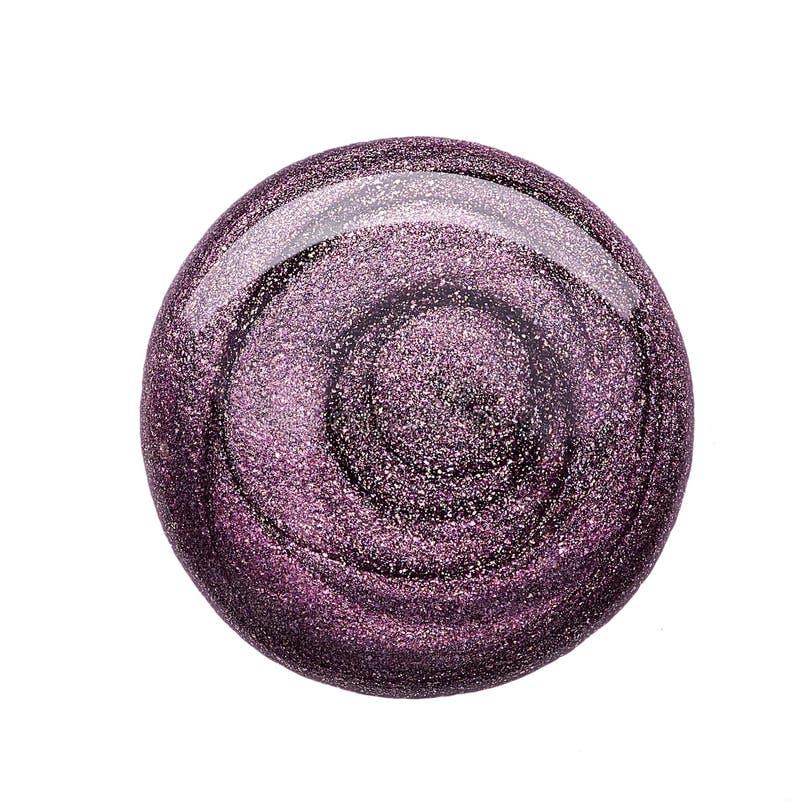 Esmalte de uñas del color de moda púrpura oscuro imagen de archivo