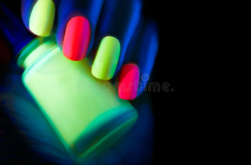 Esmalte De Uñas Fluorescente Foto de archivo - Imagen de extracto ...