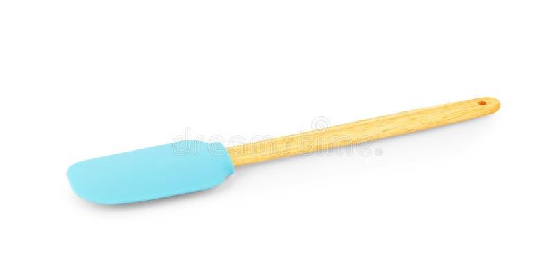 Espátula do silicone com o punho de madeira no fundo branco foto de stock royalty free