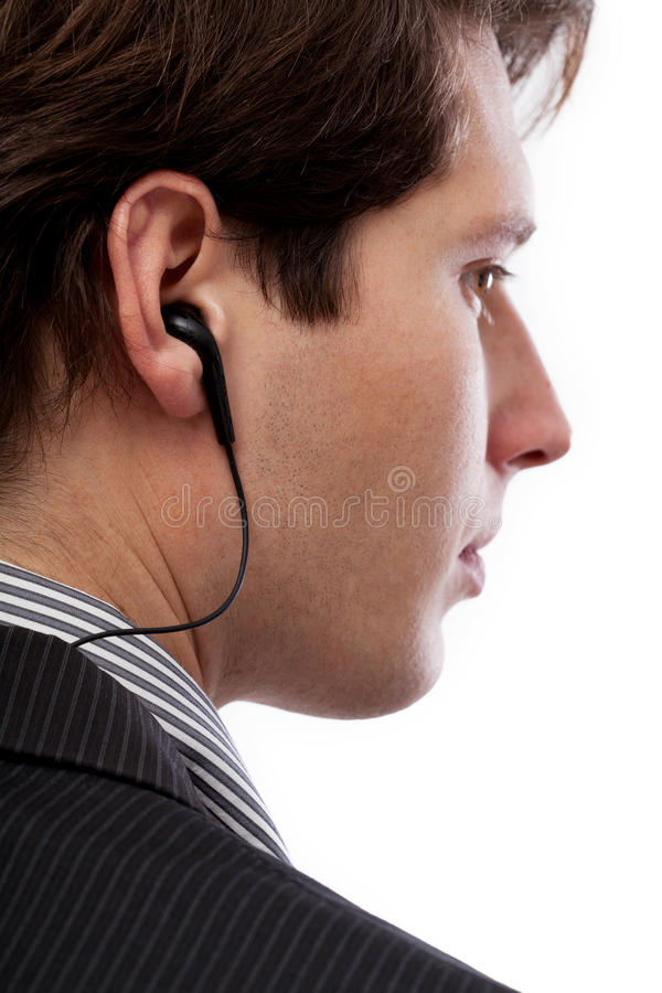 Espía con el auricular imagen de archivo