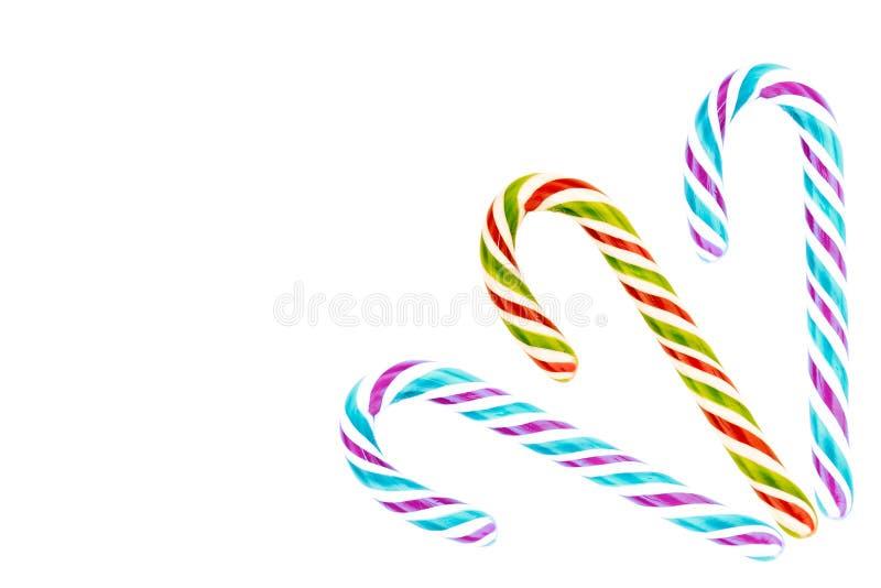Espaço tradicional da cópia do quadro do ângulo direito do Natal da sobremesa de três cana-de-açúcar Violeta azul verde vermelha  imagem de stock royalty free