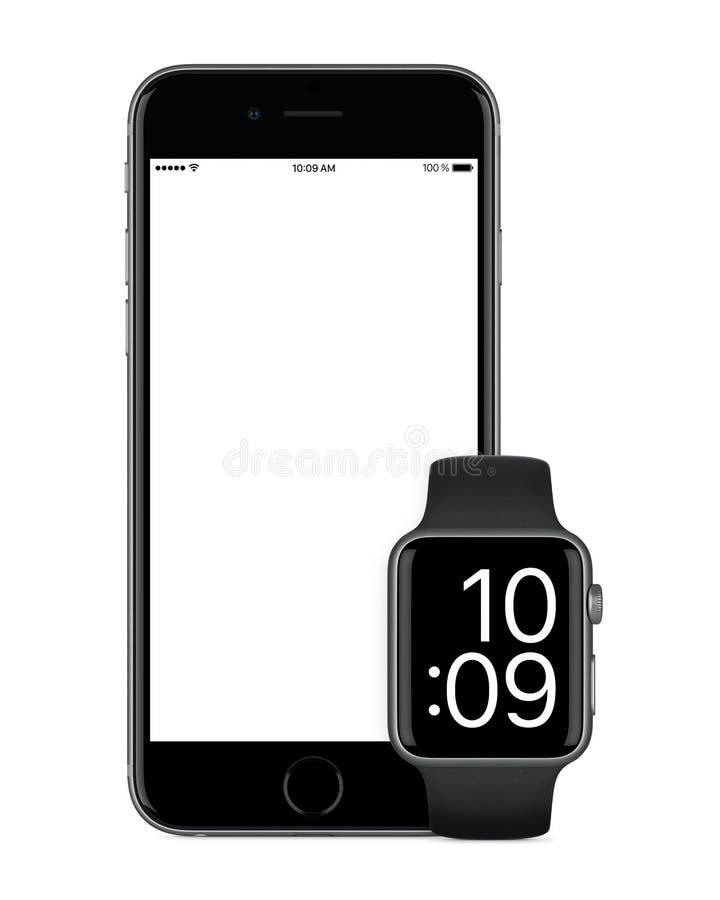 Espacie el iPhone 6s de Gray Apple y espacie la maqueta de Gray Apple Watch foto de archivo libre de regalías
