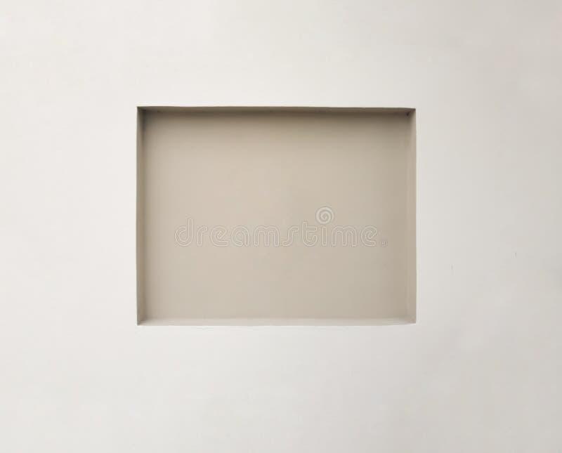 Espacio cuadrado ahuecado vacío en una pared, para el arte de exhibición o colgante Espacio de centro del foco dentro con el es fotos de archivo libres de regalías