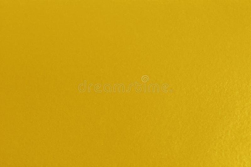 Espacio en blanco de la textura del fondo del oro para el diseño imagenes de archivo