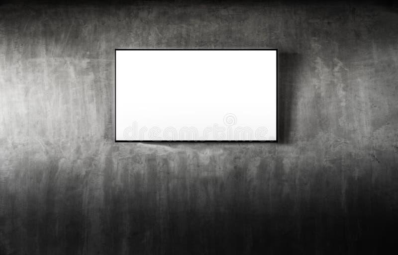 Espacio en blanco negro de la maqueta de la televisión del LED TV en fondo concreto gris La sala de estar llevó la TV en el muro  fotografía de archivo libre de regalías