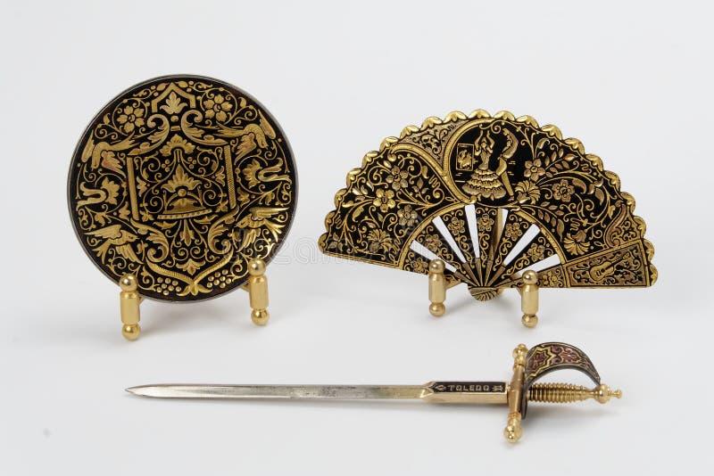 Espada, placa y ventilador españoles imagen de archivo