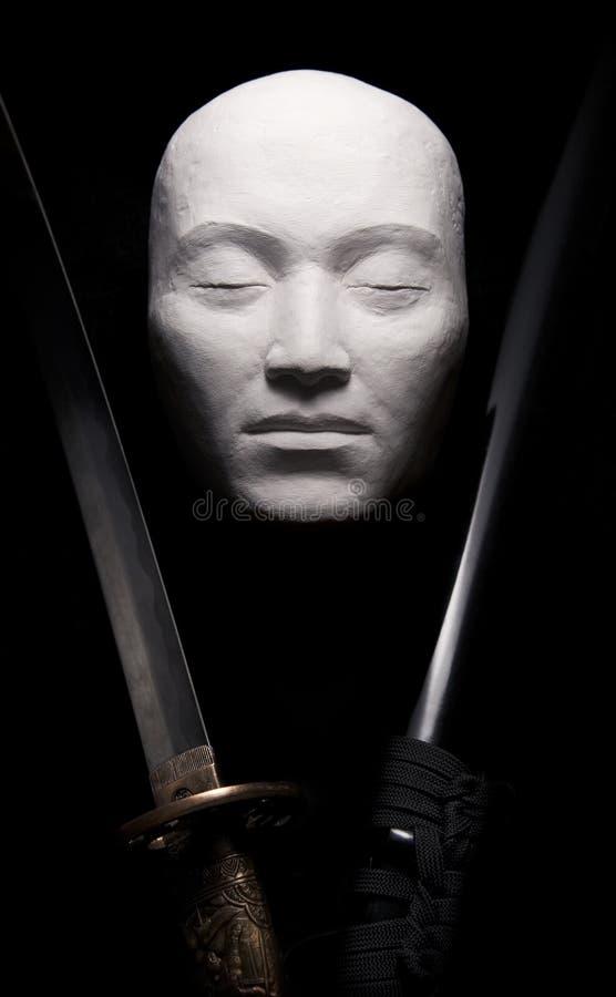 Espada y máscara fotografía de archivo libre de regalías