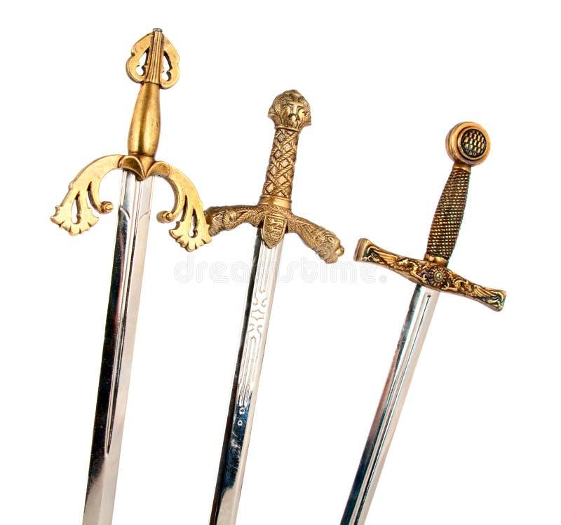 Espadas isoladas imagens de stock