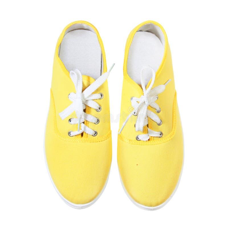 Espadrilles jaunes d'isolement sur le fond blanc photographie stock
