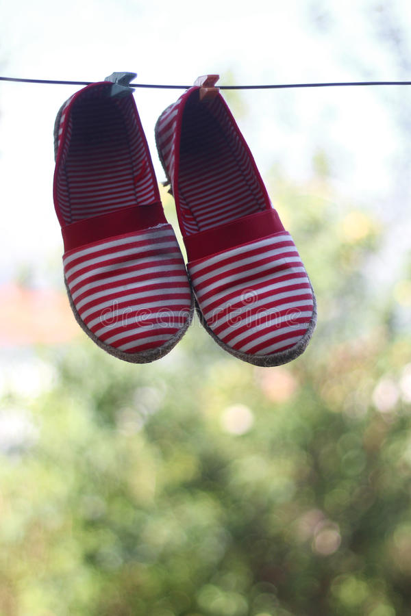 Espadrilles. Striped espadrilles drying outdoor. Selective focus royalty free stock photography