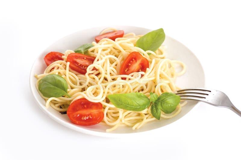 Espaguete com tomates fotografia de stock royalty free