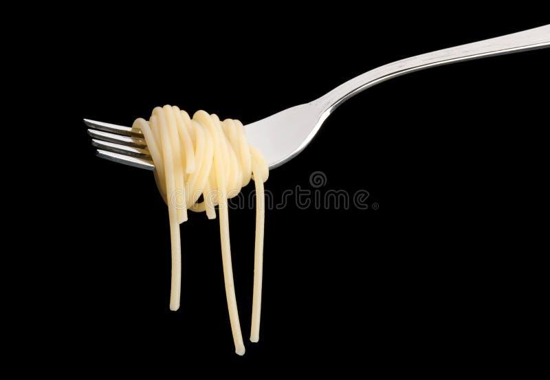 Espaguetis deliciosos en un primer de la bifurcación foto de archivo libre de regalías