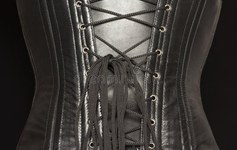 Espartilho de couro preto. fotos de stock royalty free
