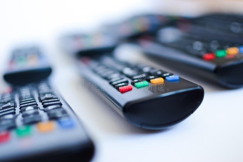 Especially heavily blurred black remote controls for the TV on a white background royalty free stock photography