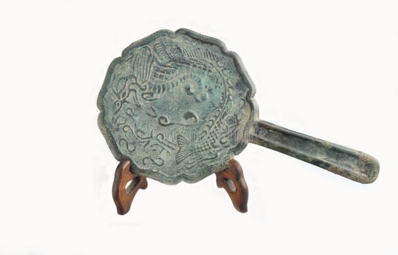Espejo del bronce de la manija del dragón del grano de los pescados de la dinastía de la canción de China imagen de archivo libre de regalías