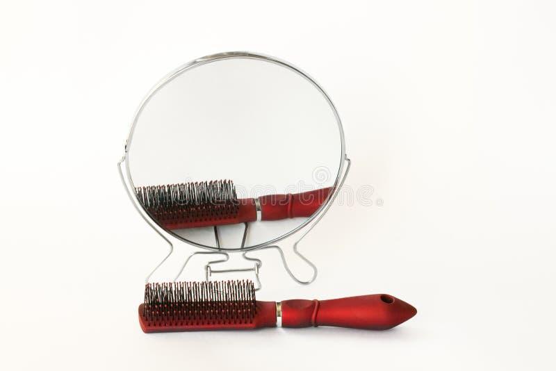 Espejo y peine imagenes de archivo