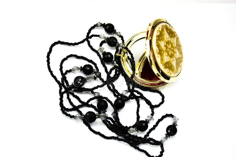 Espelho e grânulos do bolso foto de stock royalty free