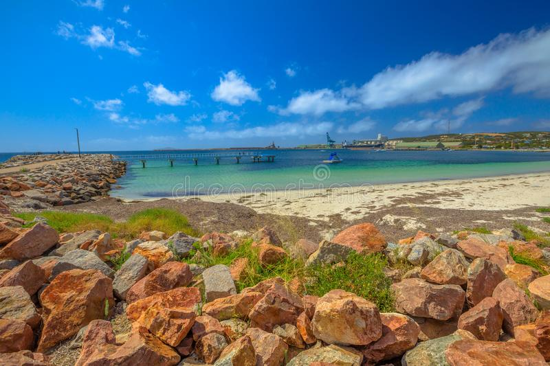 Esperance Australia Jetty. The turquoise sea and beach near the Whale Tail sculpture in Esperance Waterfront. The jetty extends out into Esperance Bay from the royalty free stock images