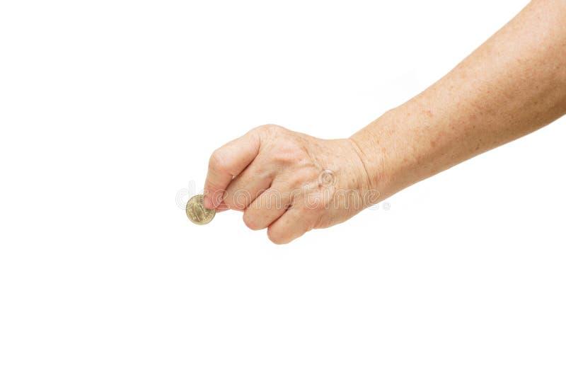 Esperto della femmina che tiene una moneta dorata immagini stock