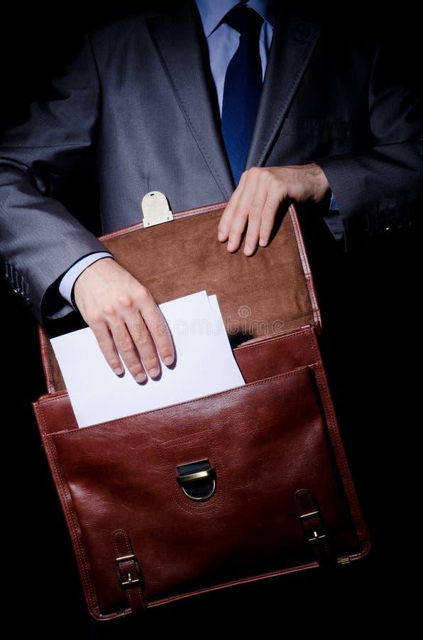 Espião do negócio com pasta foto de stock royalty free