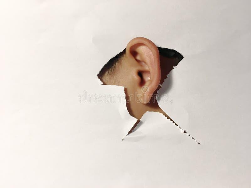 Espionnage de écoute clandestine d'oreille photographie stock libre de droits