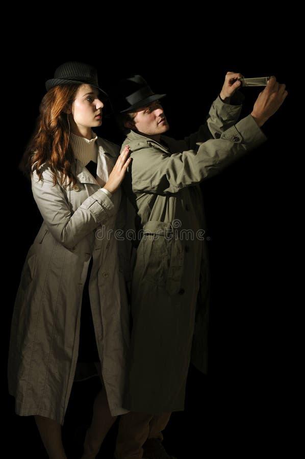 Espions d'homme et de femme photo stock