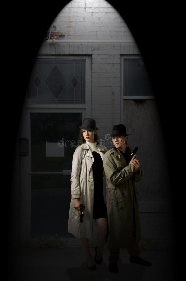Espions d'homme et de femme image libre de droits