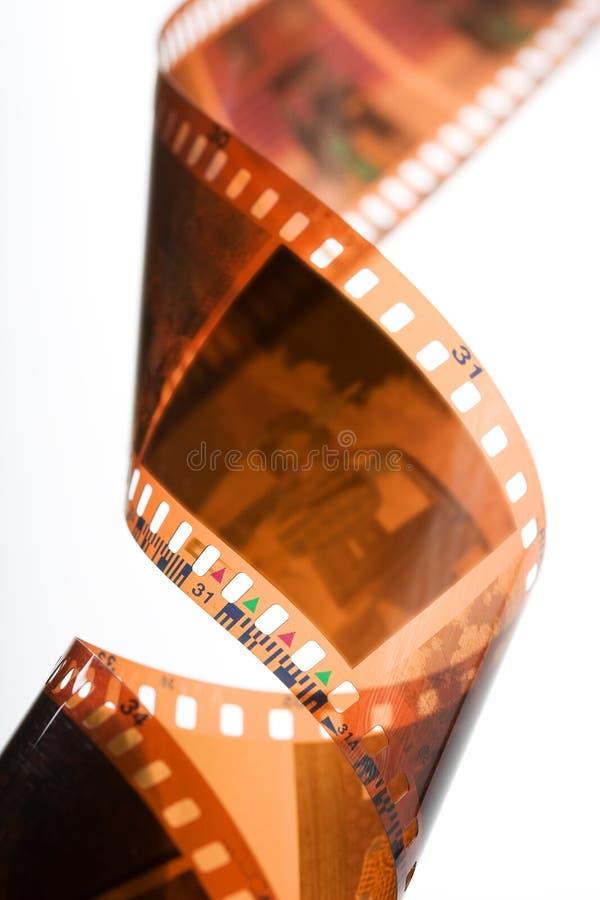 Espiral de la tira de la película negativa del color imágenes de archivo libres de regalías