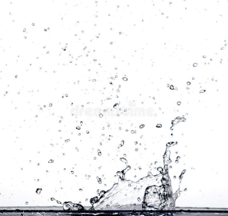 Espirrando a água fotografia de stock