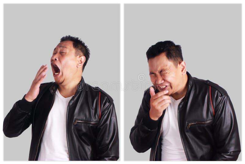 Espirrar asiático engraçado do homem fotos de stock royalty free