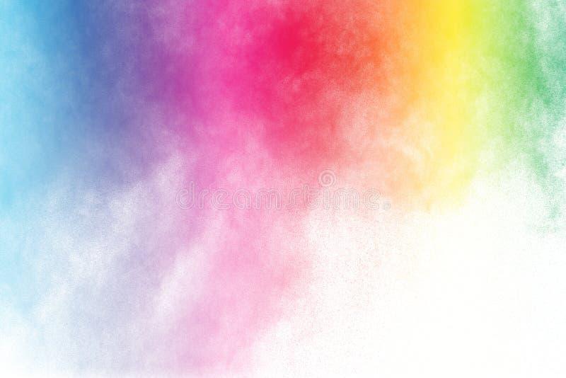 Esplosione della polvere di colore isolata su fondo bianco immagine stock